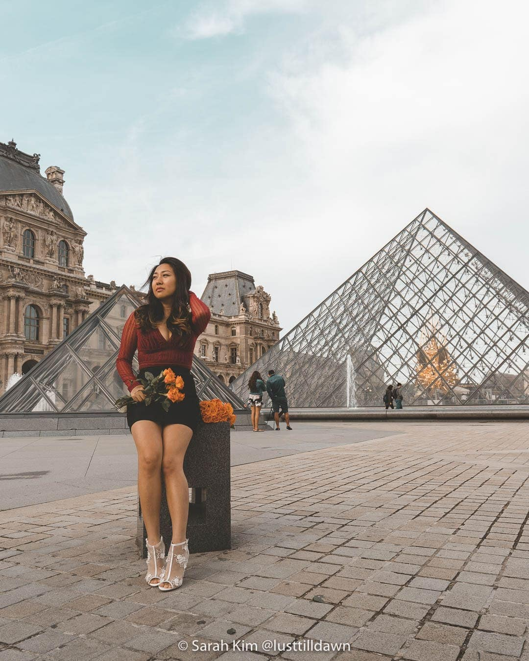 Wide fit bridal shoes worn in front of the Louvre museum in Paris