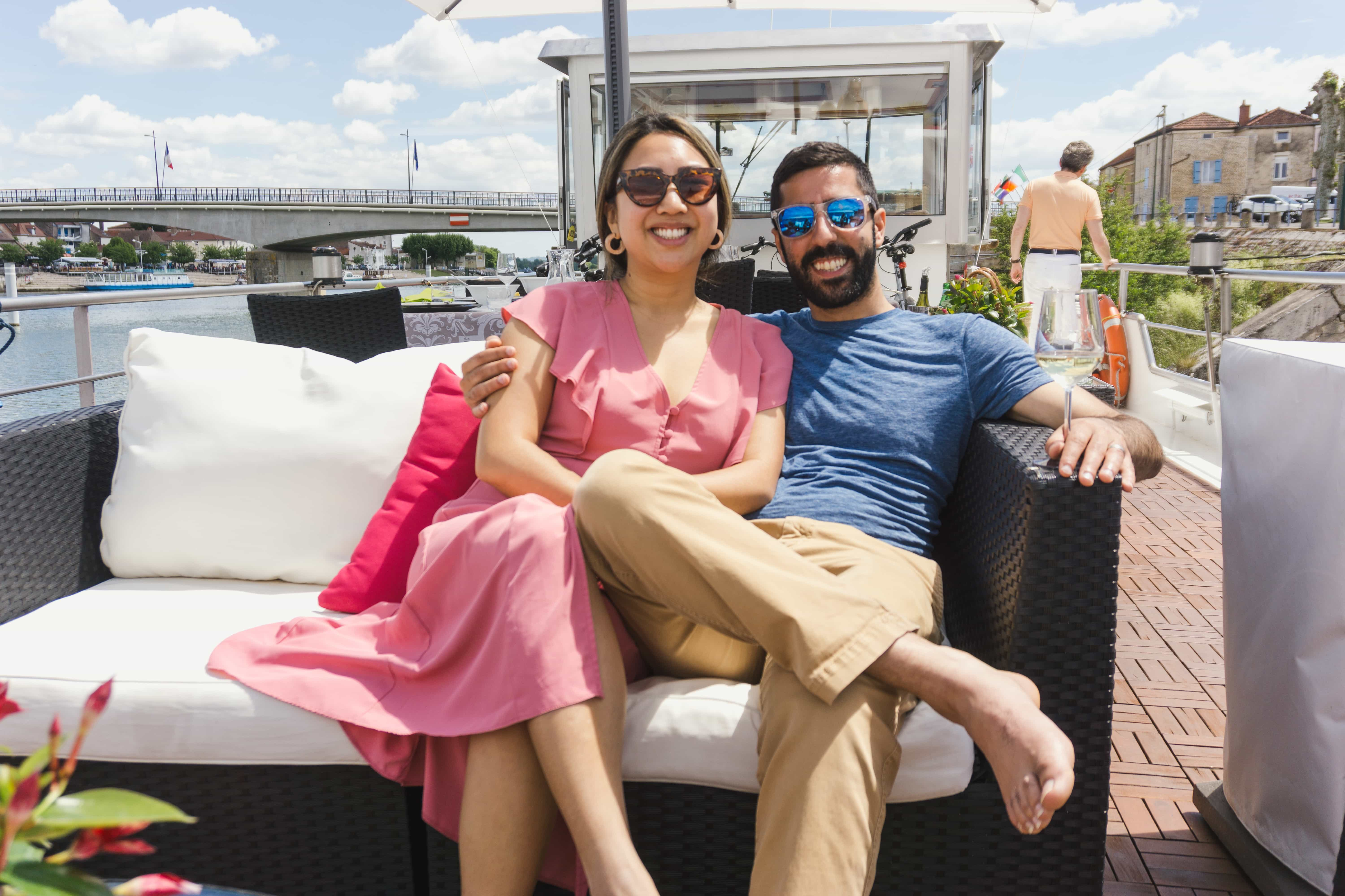 Man and woman enjoying the sun on a French barge cruise