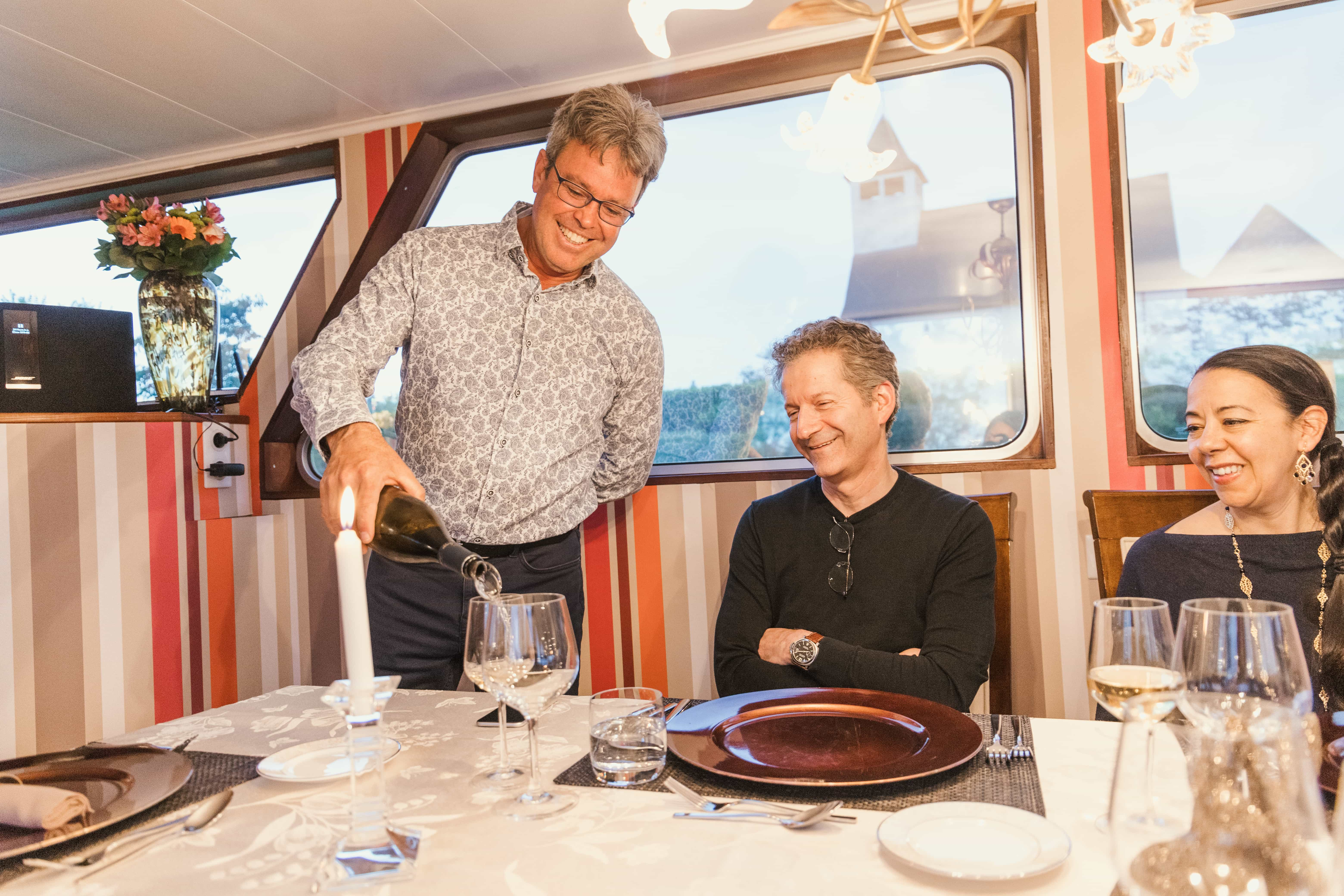 Getting served wine on a French barge cruise