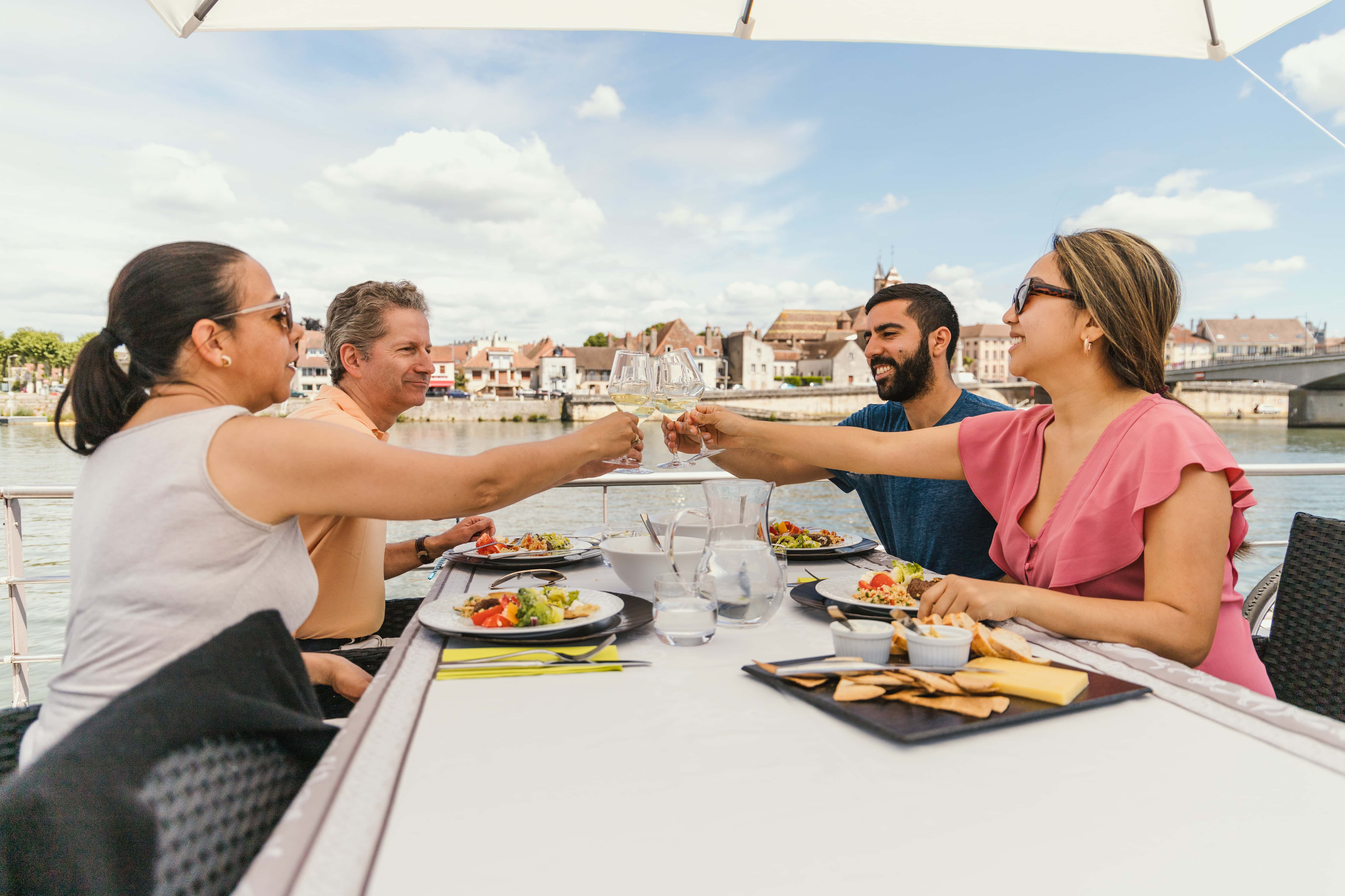 Four cruisers enjoying lunch outdoors while cruising the canals in France on Grand Victoria Cruises