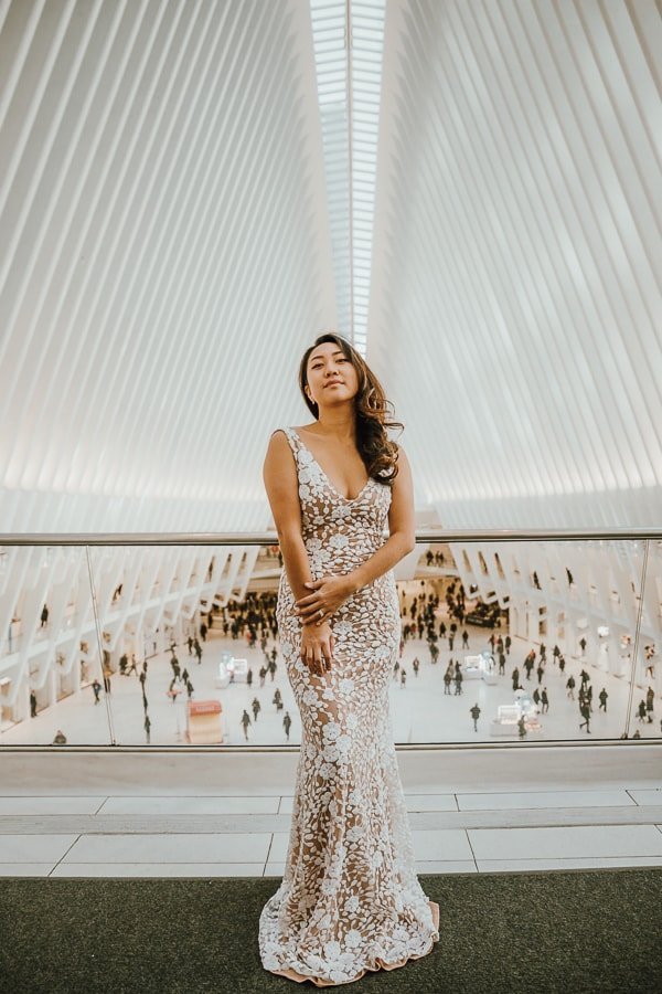 bride taking a photo at the Oculus, best ny photo location; dress by Son Jung Wan