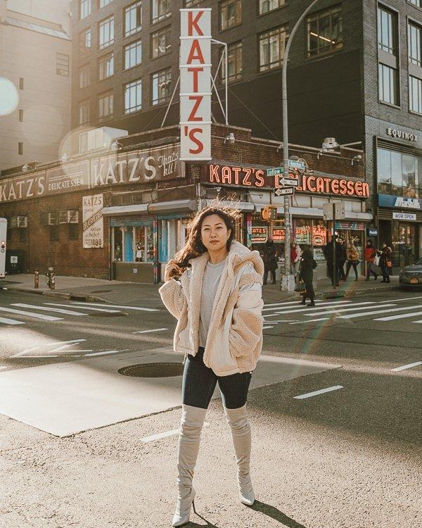woman in front of Kat'z Delicatessen, one of the best nyc instagram spots